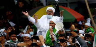 Rizieq Shihab, the leader of Indonesian Islamic Defenders Front (FPI), is greeted by supporters at the Tanah Abang, Jakarta, Indonesia, Nov. 10. (Photo by Ajeng Dinar Ulfiana/Reuters)