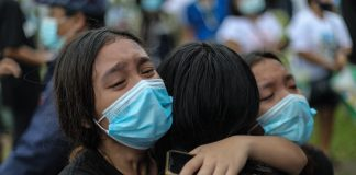 A family member cries in grief at the funeral of mother and son Sonia and Frank Anthony Gregorio, who were killed by a police officer in the province of Tarlac on Dec. 20. (Photo by Jire Carreon)
