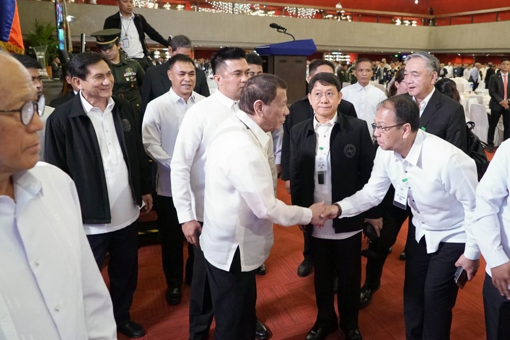 President Rodrigo Duterte is greeted by Presidential Adviser on the Peace Process Carlito Galvez Jr. during the annual general membership meeting of the Philippine Military Academy Alumni Association Inc. in January 2020. (Photo by King Rodriguez / Presidential Photo)