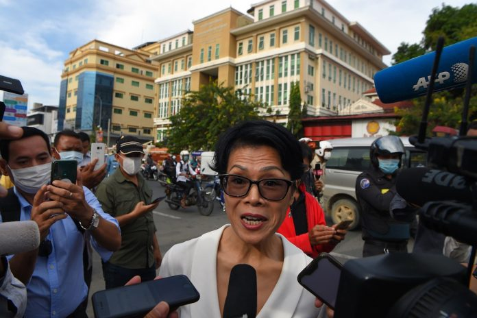 Cambodian-American human rights advocate Theary Seng speaks to the media before a hearing at Phnom Penh municipal court in Phnom Penh on Nov. 26, 2020, during a mass trial against more than 100 opposition members and activists charged with conspiracy to commit treason related to self-exiled opposition figurehead Sam Rainsy's failed plan return to the country in 2019. (Photo by Tang Chhin Sothy/AFP)