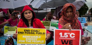 Pro-environment activists hold a demonstration calling for an end to the use of dirty energy in Manila in this photo taken in 2019. (File photo by Mark Saludes)