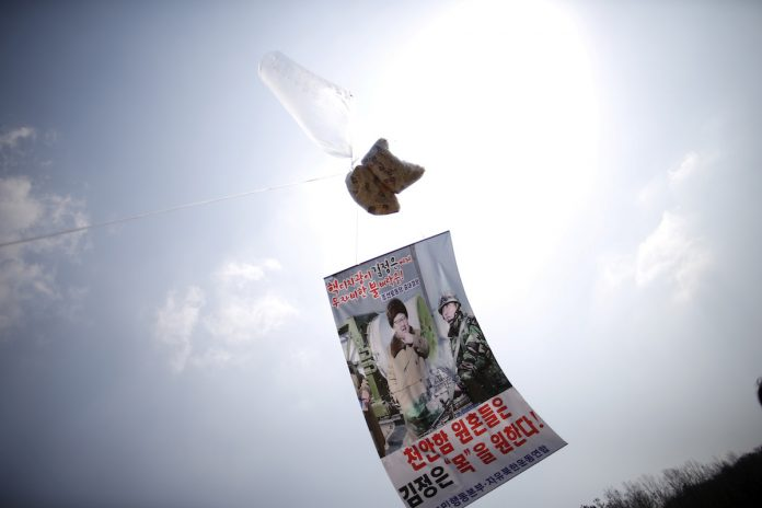 A balloon containing leaflets denouncing North Korean leader Kim Jong Un is seen near the demilitarized zone separating the two Koreas in Paju, South Korea, March 26, 2016. (Photo by Kim Hong-Ji/Reuters)