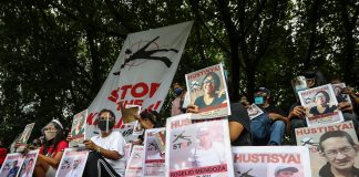 Human rights groups display photographs of activists who were reported killed in the Philippines in recent months during a demonstration in Quezon City on Aug. 19, 2020. (Photo by Jire Carreon)