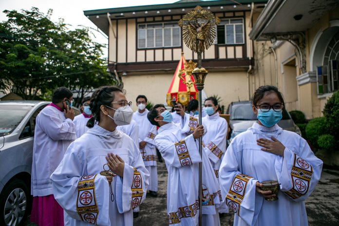 Women acolytes prepare for the celebration of the Holy Eucharist at the Minor Basilica de San Pedro in Quezon City, Philippines, in September 2020. (Photo by Mark Saludes)