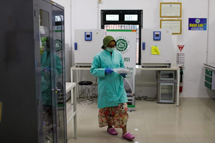 An analyst of Global Halal Center walks inside a laboratory, where the Sinovac's vaccine for COVID-19 was analyzed for Halal certification, in Bogor, Indonesia, Jan. 6. (Photo by Willy Kurniawan/Reuters)