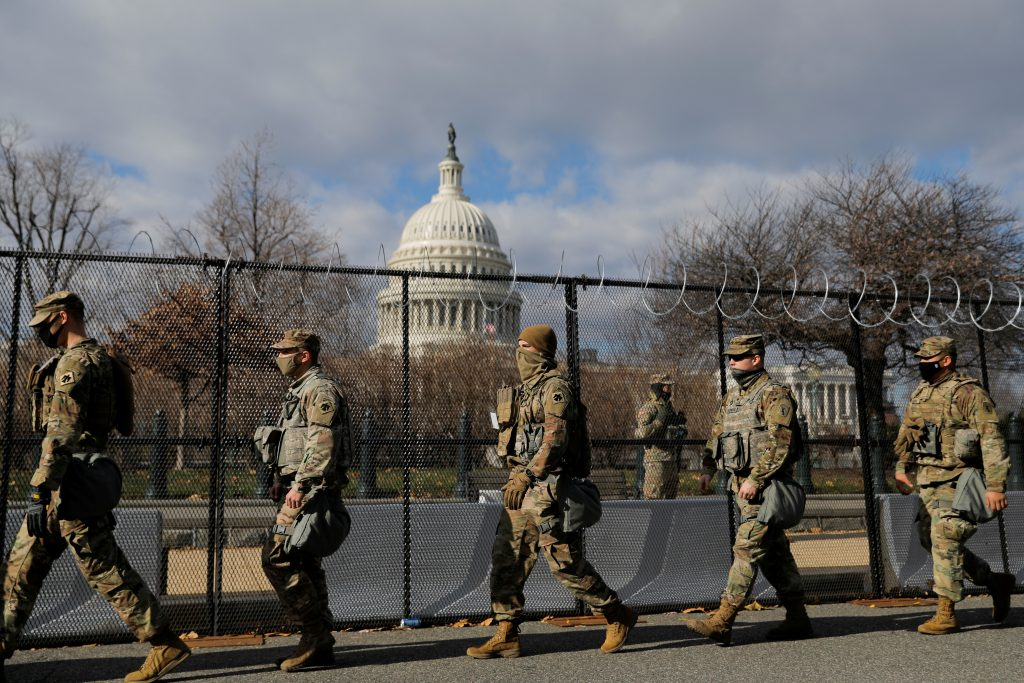 Members of the National Guard patrol near the U.S. Capitol building ahead of U.S. President Joe Biden's inauguration, in Washington, D.C., Jan. 19, 2021. (Photo by Andrew Kelly / Reuters)