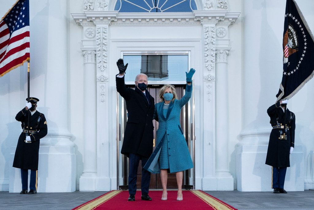 US President Joe Biden and First Lady Jill Biden wave as they arrive at the North Portico of the White House in Washington, D.C., on Jan. 20, 2021. (Photo by Alex Brandon / Pool via Reuters)
