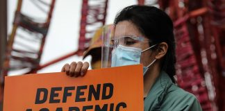 An activist holds a sign calling for academic freedom during a demonstration inside the University of the Philippines campus in Quezon City on Jan. 19, 2021. (Photo by Jire Carreon)
