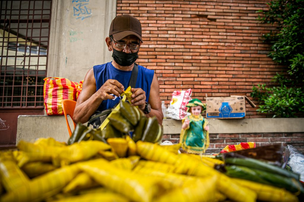 Benjamin Santos, 59, sells rice cakes outside the Shrine of the Santo Niño in Quezon City on Jan. 17, 2021. (Photo by Mark Saludes)