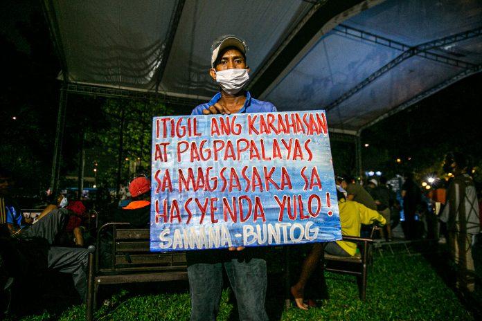 Farmer Jojo de Leon, 45, poses for the camera in this photo taken on Jan. 20, 2021, in Manila. (Photo by Mark Saludes)