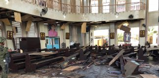 Church pews are scattered inside the Cathedral of Our Lady of Mount Carmel in the southern Philippine town of Jolo after a twin explosion killed at least 20 people and injured about 100 others on Jan. 27, 2019. (Photo courtesy of the Philippine military's Western Mindanao Command)