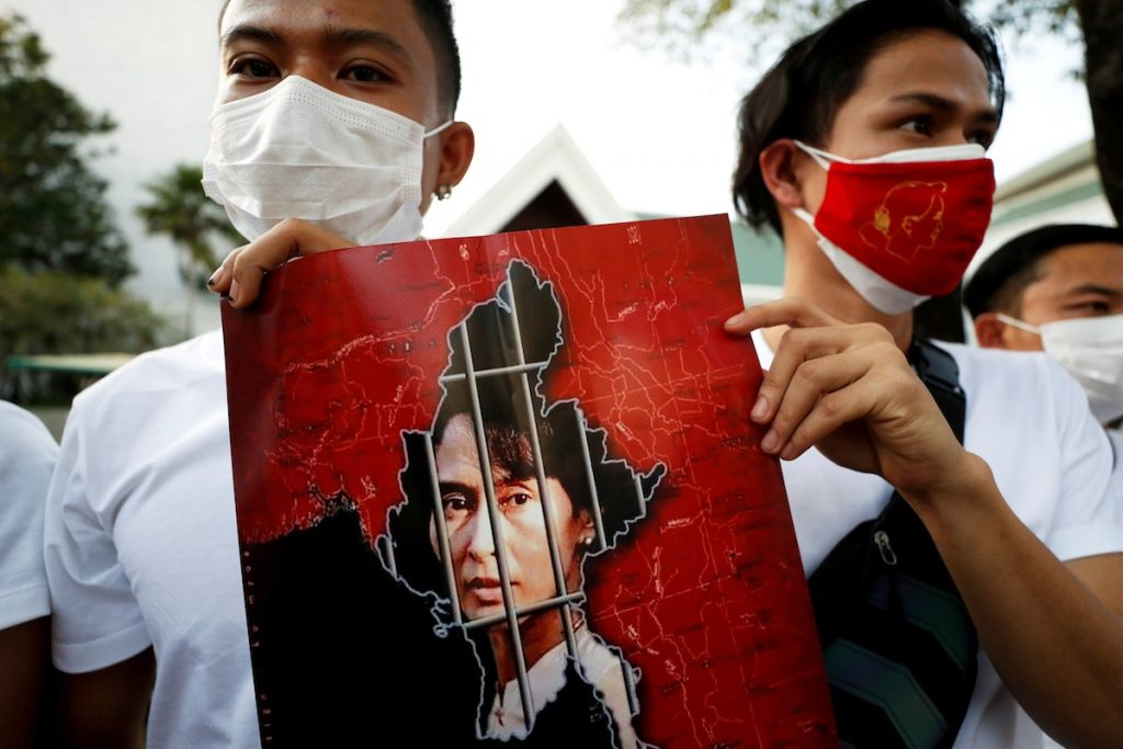 Myanmar citizens hold up a picture of leader Aung San Suu Kyi after the military seized power in a coup in Myanmar, outside United Nations venue in Bangkok, Thailand Feb. 2. (Photo by Jorge Silva/Reuters)