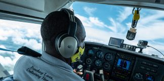 Pilot Davin Bennett of the Philippine Adventist Medical Aviation Services flies a missionary flight over in the northern Philippines. (Photo by Mark Saludes)